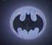 черный Бэтмен на фоне белой луны