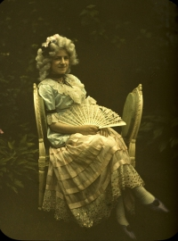 Charles Corbet, Young lady with fan on a couch    c. 1910, autochrome 12 x 9