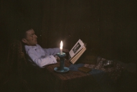 Ernest van Zuylen, E.v.Z. reading a book by candlelight - c.1917, autochrome 9 x 12